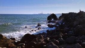 Waves crashing the rocks stock video footage