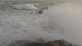 Waves crashing on rocks, mediterranean sea,Palavas les Flots, Herault, Occitanie,  France