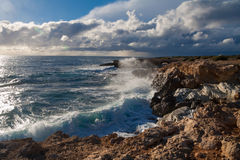 Waves crashing on the rocks Stock Photo