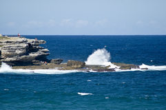 Waves crashing on rocks near bondi beach australia Stock Photo