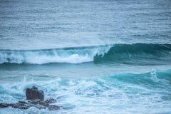 Waves Crashing into Rocks. In NSW Australia stock photo