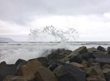 Waves crashing on rocks Pacific Ocean stock photography