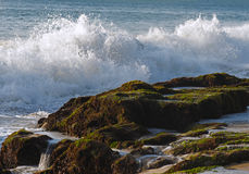 Waves crashing on the rocks. The picture was taken on Bali island Stock Photography