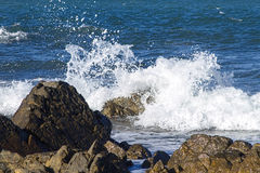 Waves crashing on rocks. Waves crashing on a rocky sea coast Royalty Free Stock Photos
