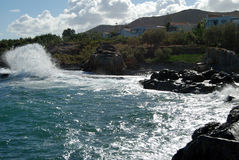Waves crashing on rocks. Sea waves crashing into the rocks on the marine coast at Greece royalty free stock photos