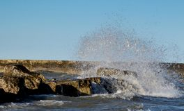 Waves Crashing on Rocks Royalty Free Stock Photos
