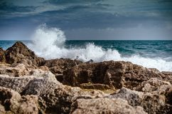 waves crashing on rocks and storm coming royalty free stock photos