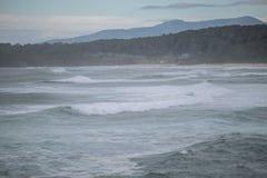 Waves Crashing into Rocks. In NSW Australia royalty free stock photography