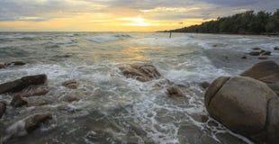 Waves crashing on a rocky beach Stock Image