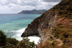 waves crashing on the rocky coast of Italy Royalty Free Stock Photography