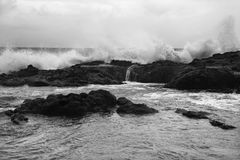 Waves crashing on rocky shore. Royalty Free Stock Photography