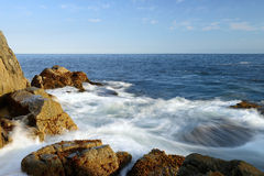 Waves crashing in a rocky shore. At Peggey's Cove Royalty Free Stock Photo