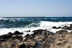 Waves crashing on rocky shore Stock Photography