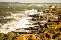 Waves crashing at rocky shore in swedish landscape Stock Photos