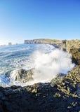 Waves crashing on rocky south coast of  Iceland Stock Photo