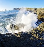 Waves crashing on rocky south coast of  Iceland Royalty Free Stock Images