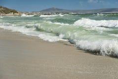 Waves crashing on the sand Royalty Free Stock Images