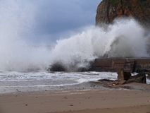 Waves crashing on sea wall and rocks at Hope Cove harbour in Devon, England. 2 Stock Photo