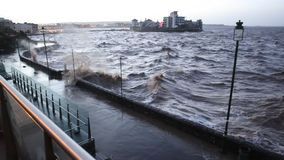 Waves crashing on seafront Weston-super-Mare Somerset Friday 3rd January 2014 Stock Photos