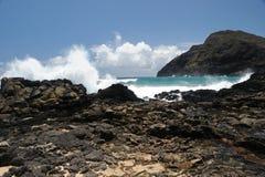 Waves crashing on seashore. Rocks, Makapuu beach, Oahu, Hawaii Stock Photography