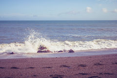 Waves crashing on shingle beach Stock Image