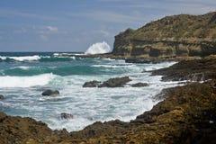 Waves crashing on shore. Waves on the rocky Shore at Montanita Ecuador Stock Photo