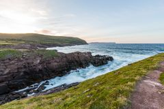 Waves crashing into the shore of Cape Spear, Newfoundland Stock Images