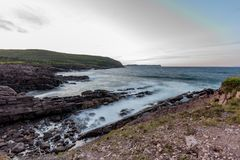 Waves crashing into the shore of Cape Spear, Newfoundland Royalty Free Stock Photos