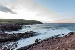 Waves crashing into the shore of Cape Spear, Newfoundland. Waves crash over the shores of Newfoundland on a regular basis. With its completely exposed shoreline Royalty Free Stock Image