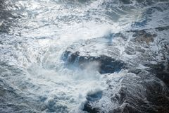 Waves crashing on the shore royalty free stock image
