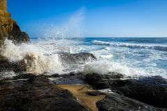 Waves crashing on shore stock photos