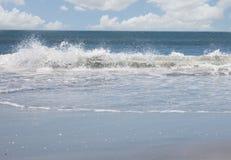 Waves crashing on shore Stock Photo