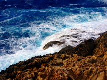 Waves crashing on the shoreline. In mediterranean sea Stock Images