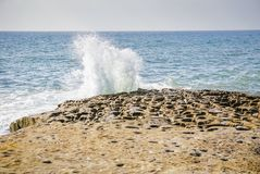 Waves Crashing at Sunset Cliffs Natural Park near La Jolla, San Diego California. Views of waves crashing on the rocks and the Pacific Ocean off the California stock photo