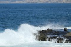 Waves crashing on to a cliff in LaJolla California Royalty Free Stock Photo
