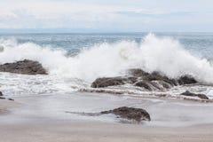 Waves crashing to rocks montezuma beach. Costa Rica Stock Images