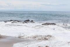 Waves crashing to rocks montezuma beach. Costa Rica Stock Image