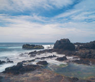 Waves crashing on to rocks. Rock slabs covered from the beach with a beautiful view. This beautiful view at Cape schanck in the Mornington peninsula is an Stock Images