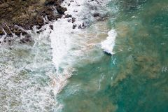 Waves crashing on to rocks. Taken at Lake Cathie NSW, Australia the image gives a straight down view of waves crashing on to Middle Rock Royalty Free Stock Image