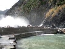 Waves crashing on the vernazza coast north italy b Stock Image