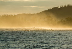Waves create spray at dawn at Hanalei Royalty Free Stock Photo