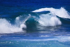 Waves cresting and breaking Royalty Free Stock Photography
