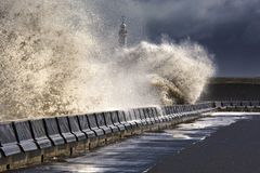 Waves Crushing Against Barrier Royalty Free Stock Photo