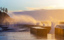 Waves crushing with force on Mornington Pier Stock Images