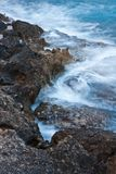 Waves crushing onto rocks Stock Photography