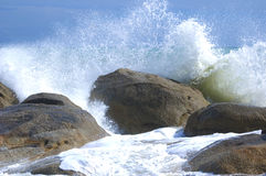 Waves crushing into the rocks Stock Photography