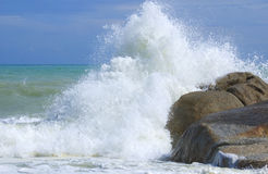 Waves crushing into the rocks Stock Images