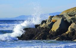 Waves crushing into the rocks Stock Photos