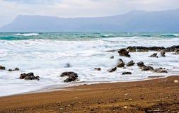 Waves crushing on the rocks. Beach landscape with stormy foamy waves crushing on the rocks stock photos