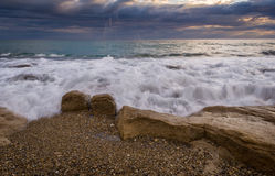 Waves crushing on the rocks and dramatic sky in Corfu Greece.  Royalty Free Stock Photos